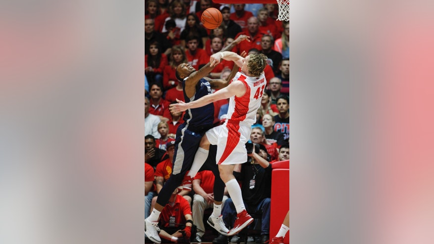Utah State's Jarred Shaw's shot is blocked by New Mexico's Cameron Bairstow (41) during the second half of an NCAA college basketball game, Tuesday, Feb.25, 2014 in Albuquerque, N.M. New Mexico won 67-58. (AP Photo/Craig Fritz)