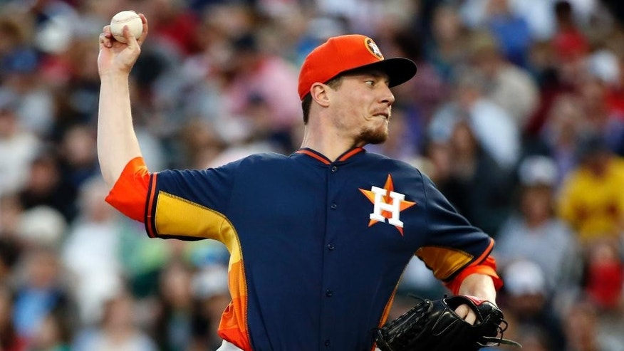 Houston Astros starting pitcher Lucas Harrell throws in the first inning of an exhibition baseball game against the Atlanta Braves, Friday, Feb. 28, 2014, in Kissimmee, Fla. (AP Photo/Alex Brandon)