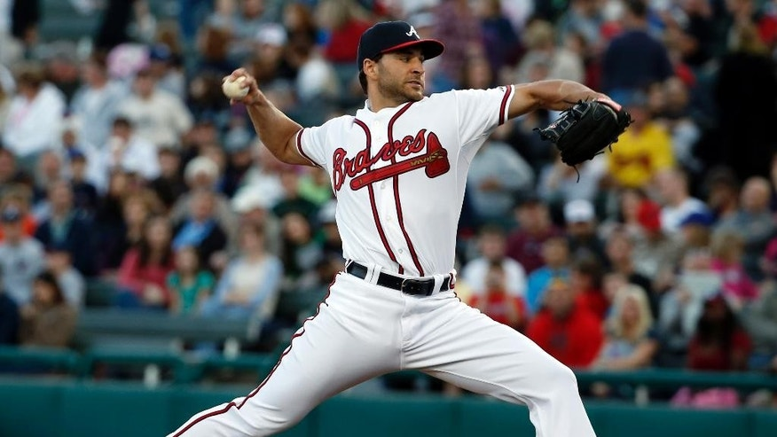 Atlanta Braves starting pitcher Brandon Beachy throws in the first inning of a spring exhibition baseball game against the Houston Astros, Friday, Feb. 28, 2014, in Kissimmee, Fla. (AP Photo/Alex Brandon)