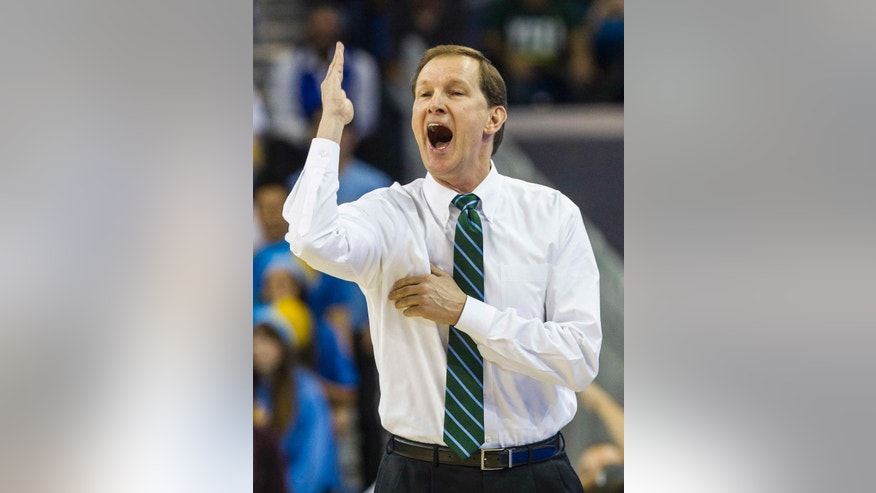 Oregon head coach Dana Altman encourages his team against UCLA in the first half of an NCAA college basketball game Thursday, Feb. 27, 2014, in Los Angeles. (AP Photo/Ringo H.W. Chiu)