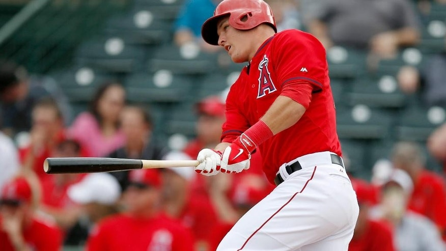 Los Angeles Angels' Mike Trout watches his single in the second inning during a spring training baseball game against the Chicago Cubs on Friday, Feb. 28, 2014, in Tempe, Ariz. (AP Photo/Ross D. Franklin)