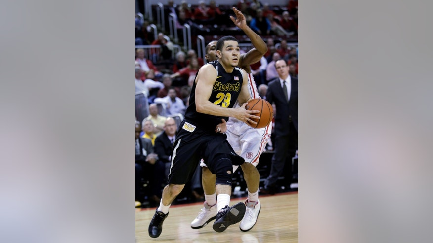 Wichita State guard Fred VanVleet (23) makes a move for the basket past the defense of Bradley guard Ka'Darryl Bell (0) during the second half of an NCAA college basketball game at Carver Arena, Tuesday, Feb. 25, 2014, in Peoria, Ill. Wichita State won the game 69-49. (AP Photo/ Stephen Haas)