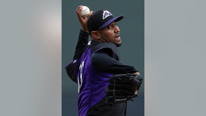 Colorado Rockies starting pitcher Franklin Morales throws against the Arizona Diamondbacks during the first inning in a spring training baseball game on Friday, Feb. 28, 2014, in Scottsdale, Ariz. (AP Photo/Gregory Bull)