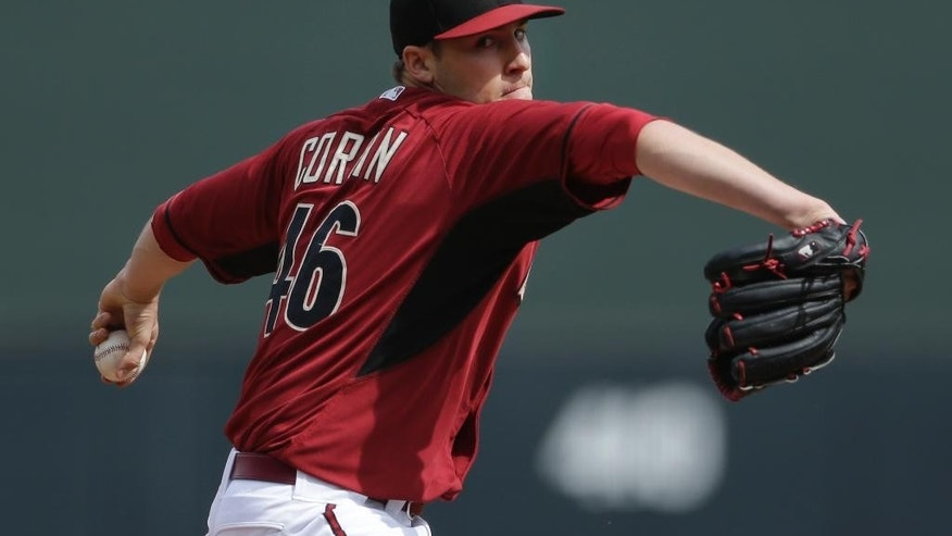 Arizona Diamondbacks starting pitcher Patrick Corbin throws against the Colorado Rockies during the first inning in a spring training baseball game on Friday, Feb. 28, 2014, in Scottsdale, Ariz. (AP Photo/Gregory Bull)