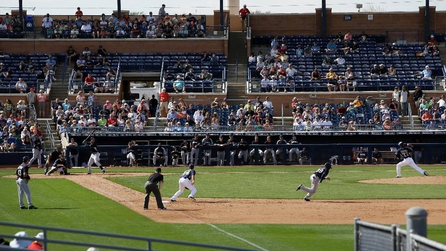 Seattle Mariners' Xavier Avery steals second as San Diego Padres relief pitcher Leonel Campos delivers to the plate during the fifth inning of an exhibition baseball game, Friday, Feb. 28, 2014, in Peoria, Ariz. (AP Photo/Tony Gutierrez)