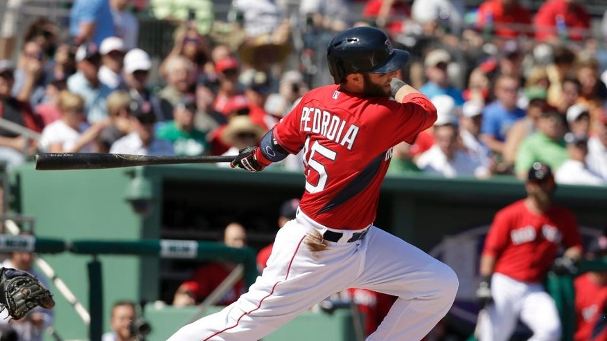 Boston Red Sox second baseman Dustin Pedroia follows through on a swing as he grounds out off a pitch by Minnesota Twins Mike Pelfrey in the first inning of an exhibition baseball game Friday, Feb. 28, 2014, in Fort Myers, Fla. (AP Photo/Steven Senne)