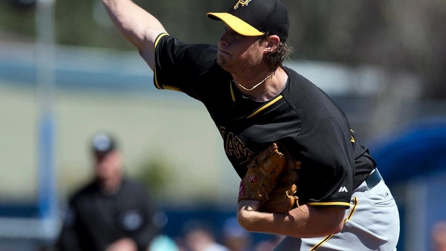 Pittsburgh Pirates starter Gerrit Cole throws in the first inning of a spring exhibition baseball game against the Toronto Blue Jays in Dunedin, Fla.,  Friday Feb. 28, 2014. (AP Photo/The Canadian Press, Frank Gunn)