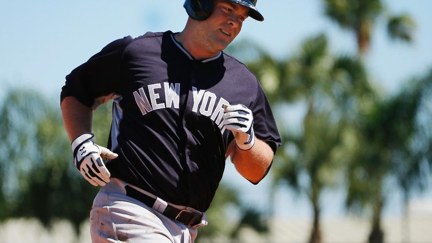 New York Yankees' Brian McCann rounds third after hitting a solo home run off Detroit Tigers starting pitcher Max Scherzer during the second inning of an exhibition spring training baseball game in Lakeland, Fla.,  Friday, Feb. 28, 2014. The Yankees won 7-4. (AP Photo/Gene J. Puskar)
