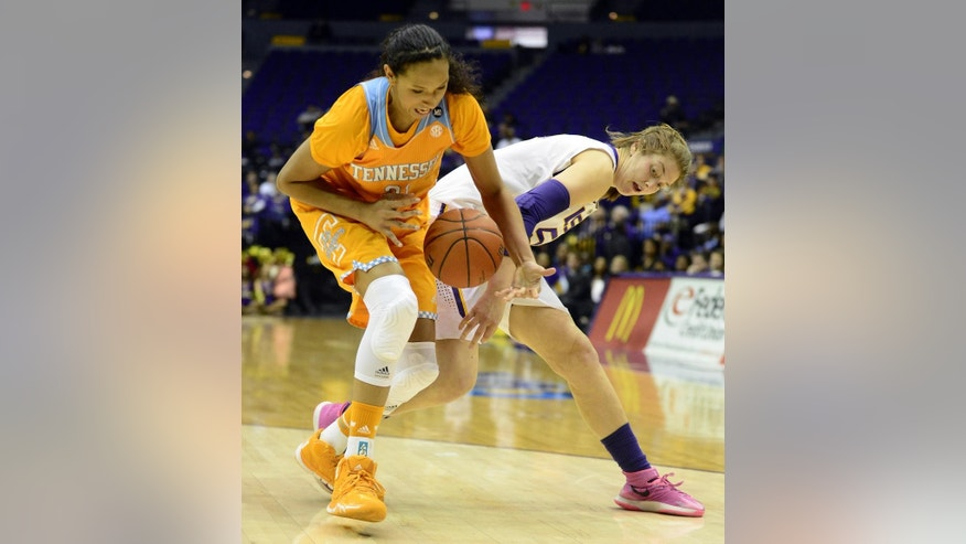 Tennessee's Mercedes Russell, left, steals the ball from LSU's Theresa Plaisance during an NCAA college basketball game in Baton Rouge, Thursday, Feb. 27, 2014. (AP Photo/The Baton Rouge Advocate, Catherine Threlkeld)  MANDATORY CREDIT, -ONLIN, MAGAZINES OUT, INTERNET OUT, TV OUT, NO SALES, NO FOREIGNS. LOUISIANA BUSINESS INC. OUT (INCLUDING GREATER BATON ROUGE BUSINESS REPORT, 225, 10/12, INREGISTER, LBI CUSTOM