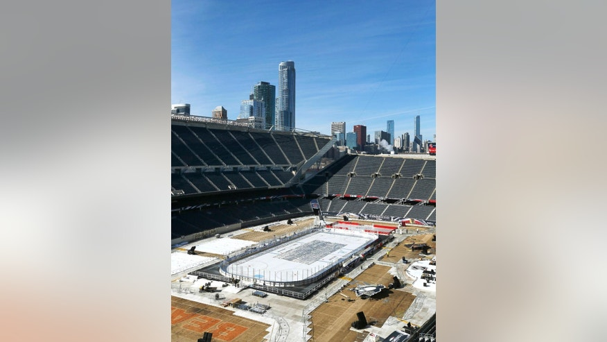 Work continues to transform Soldier Field for Saturday's Stadium Series NHL hockey game between the Chicago Blackhawks and Pittsburgh Penguins, Thursday, Feb. 27, 2014, in Chicago. (AP Photo/Charles Rex Arbogast)