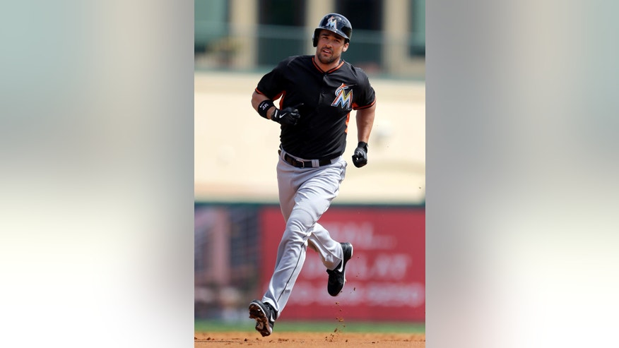 Miami Marlins' Garrett Jones rounds the bases after hitting a two-run home run during the first inning of an exhibition spring training baseball game against the St. Louis Cardinals Friday, Feb. 28, 2014, in Jupiter, Fla. (AP Photo/Jeff Roberson)