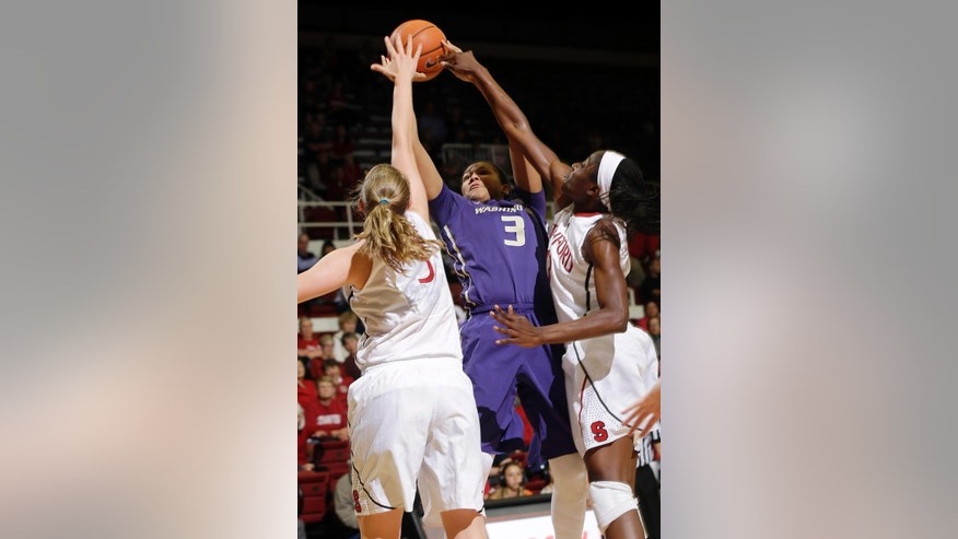 Washington forward Talia Walton (3) tries to shoot between Stanford forward Mikaela Ruef, left, and forward Chiney Ogwumike during the first half of an NCAA college basketball game, Thursday, Feb. 27, 2014, in Stanford, Calif. (AP Photo/Marcio Jose Sanchez)