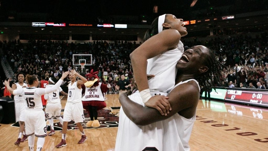 South Carolina's Tiffany Mitchell, left, and Aleighsa Welch celebrate the team's 67-56 win over Georgia in an NCAAA college basketball game Thursday, Feb. 27, 2014, in Columbia, S.C. South Carolina won the Southeastern Conference title. (AP Photo/Mary Ann Chastain)