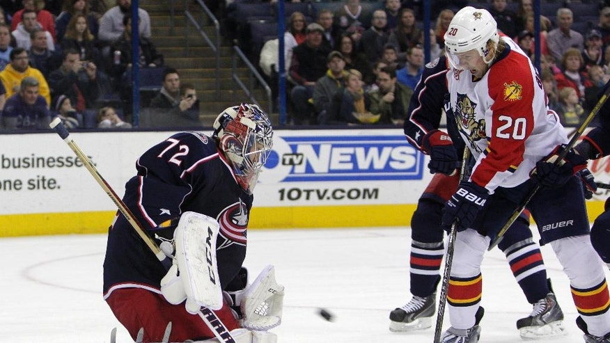 Columbus Blue Jackets' Sergei Bobrovsky, of Russia, makes a save against Florida Panthers' Sean Bergenheim, of Finland, during the first period of an NHL hockey game Saturday, March 1, 2014, in Columbus, Ohio. (AP Photo/Jay LaPrete)