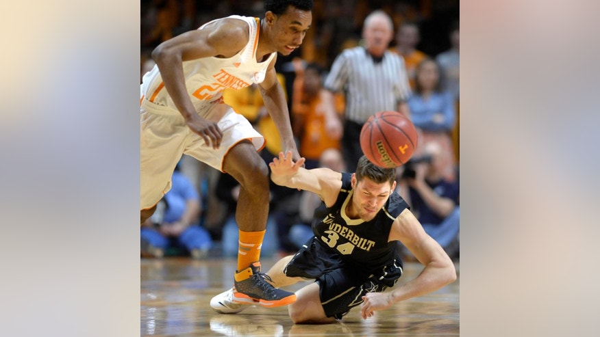 Tennessee guard Derek Reese (23) makes a steal from Vanderbilt forward Shelby Moats (34) during the first half of an NCAA college basketball game at the Thompson-Boling Arena in Knoxville, Tenn. on Saturday, March 1, 2014.  (AP Photo/Knoxville News Sentinel, Adam Lau)