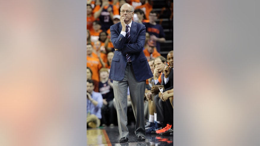 Syracuse head coach Jim Boeheim watches his team during the first half of an NCAA College basketball game in Charlottesville, Va., Saturday, March 1, 2014.  (AP Photo/Steve Helber)