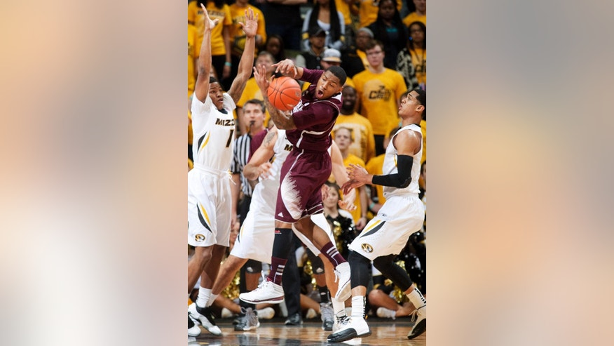 Mississippi State's Trivante Bloodman, center, loses control of a rebound between Missouri's Wes Clark, left, and Jordan Clarkson, right, during the first half of an NCAA college basketball game Saturday, March 1, 2014, in Columbia, Mo. (AP Photo/L.G. Patterson)