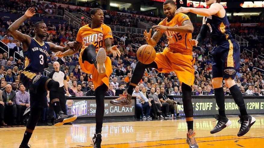 New Orleans Pelicans' Anthony Morrow (3) and Luke Babbitt (8) and Phoenix Suns' Archie Goodwin (20) and Marcus Morris (15) watch the ball during the first half of an NBA basketball game, Friday, Feb. 28, 2014, in Phoenix. (AP Photo/Matt York)