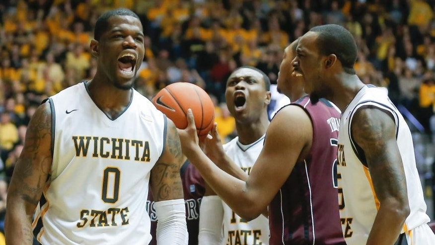 Wichita State's Chadrack Lufile (0) celebrates getting fouled by Missouri State's Devon Thomas, at center right with the ball, with teammates Cleanthony Early, middle and Nick Wiggins during the first half of an NCAA college basketball game in Wichita, Kan., Saturday, March 1, 2014. (AP Photo/The Wichita Eagle, Travis Heying) LOCAL TV OUT; MAGS OUT; LOCAL RADIO OUT; LOCAL INTERNET OUT