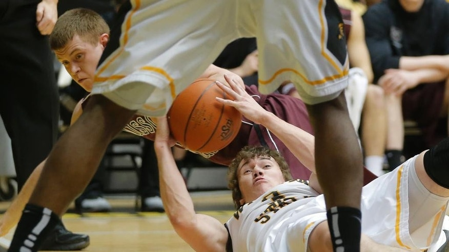 Wichita State's Evan Wessel, bottom right, scrambles for a loose ball against Missouri State's Austin Ruder, bottom left,  during the first half  of an NCAA college basketball game in Wichita, Kan., Saturday, March 1, 2014. (AP Photo/The Wichita Eagle, Travis Heying) LOCAL TV OUT; MAGS OUT; LOCAL RADIO OUT; LOCAL INTERNET OUT