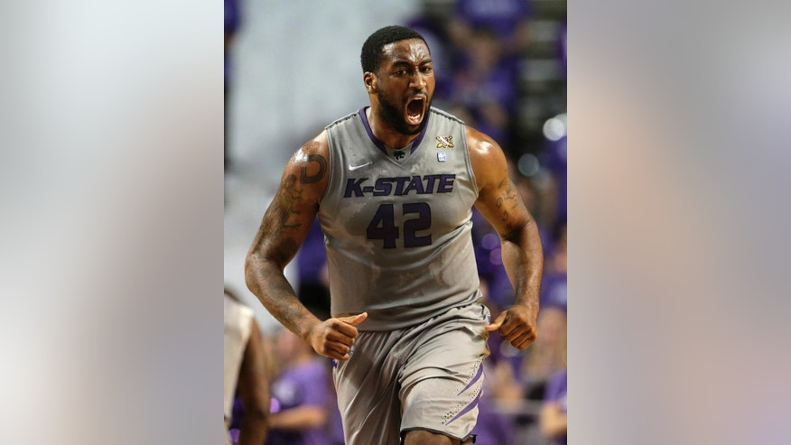 Kansas State's Thomas Gipson reacts after sinking a basket during the first half of an NCAA college basketball game against Iowa State  Saturday, March 1, 2014, in Manhattan, Kan. (AP Photo/Charlie Riedel)