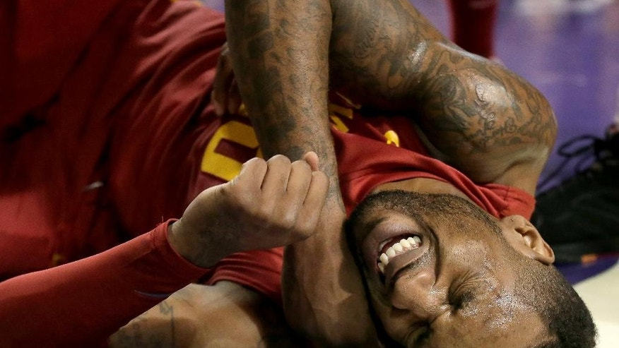 Iowa State's DeAndre Kane reacts after getting fouled during the first half of an NCAA college basketball game against Kansas State Saturday, March 1, 2014, in Manhattan, Kan. (AP Photo/Charlie Riedel)