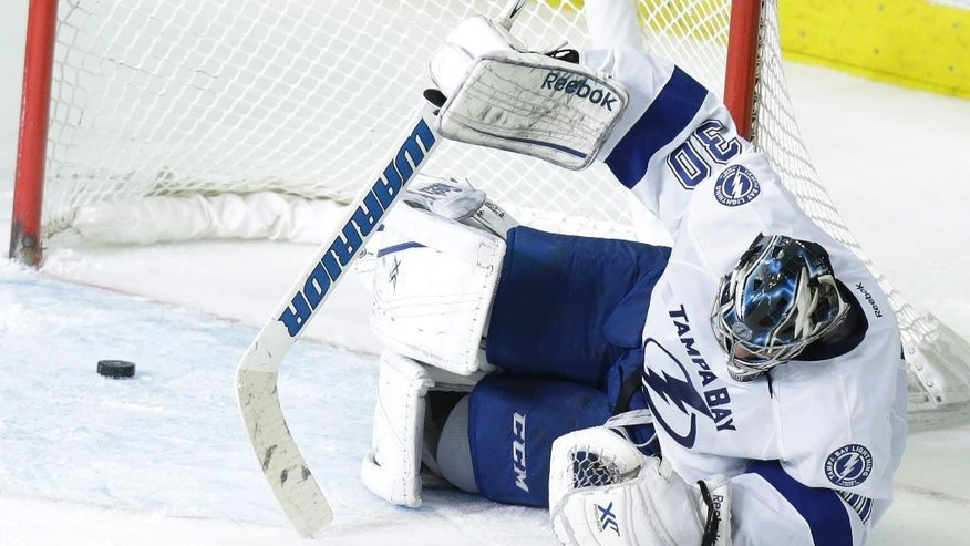Tampa Bay Lightning goalie Ben Bishop (30) lays on the ice after he was scored on by Dallas Stars center Vernon Fiddler, not shown, during the second period of an NHL hockey game Saturday, March 1, 2014, in Dallas. (AP Photo/LM Otero)