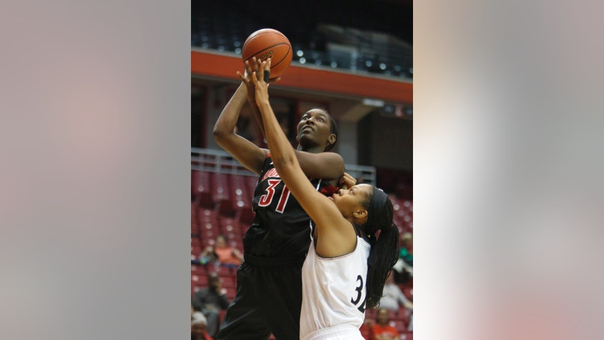 Louisville forward Asia Taylor (31) looks to shoot against Cincinnati forward Shelbi Chandler (32) during the first half of an NCAA  college basketball game, Saturday, March 1, 2014, in Cincinnati. (AP Photo/David Kohl)