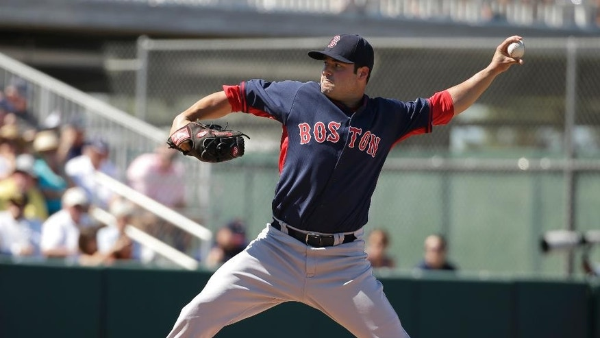 Boston Red Sox pitcher Noe Ramirez delivers a warm-up throw in the second inning of an exhibition baseball game against the Minnesota Twins, Saturday, March 1, 2014, in Fort Myers, Fla. (AP Photo/Steven Senne)