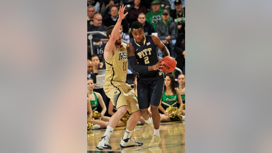 Pittsburgh forward Michael Young, right, drives against Notre Dame center Garrick Sherman in the first half of an NCAA college basketball game Saturday, March 1, 2014, in South Bend, Ind. (AP Photo/Joe Raymond)