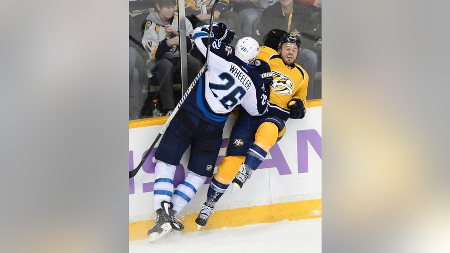 Winnipeg Jets right wing Blake Wheeler (26) checks Nashville Predators forward Viktor Stalberg (25), of Sweden, into the boards in the second period of an NHL hockey game on Saturday, March 1, 2014, in Nashville, Tenn. (AP Photo/Mark Zaleski)