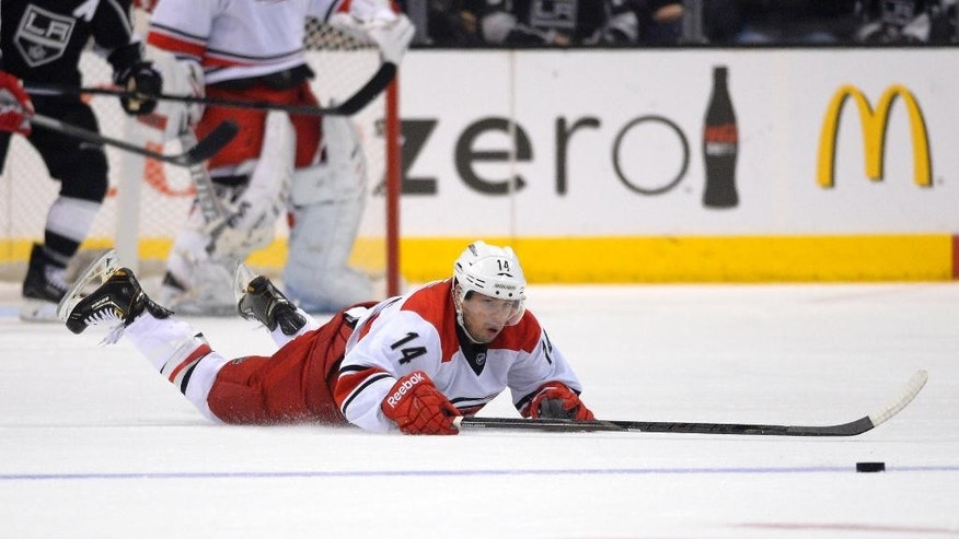 Carolina Hurricanes left wing Nathan Gerbe dives for the puck during the first period of an NHL hockey game against the Los Angeles Kings, Saturday, March 1, 2014, in Los Angeles. (AP Photo/Mark J. Terrill)