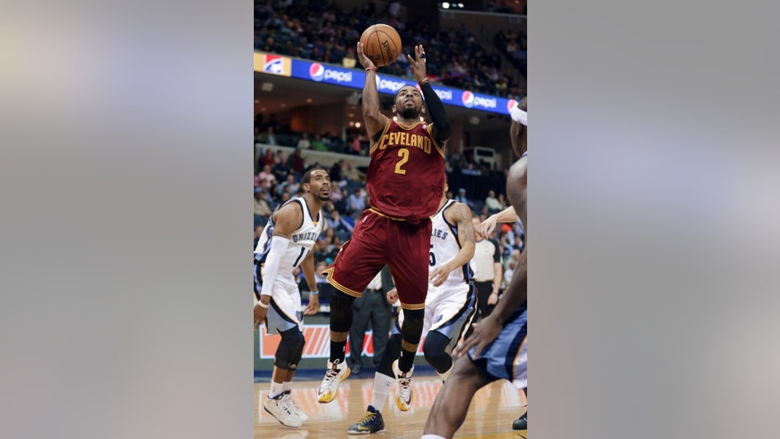 Cleveland Cavaliers' Kyrie Irving (2) goes to the basket in front of Memphis Grizzlies' Mike Conley, left, and Courtney Lee during the first half of an NBA basketball game in Memphis, Tenn., Saturday, March 1, 2014. (AP Photo/Danny Johnston)