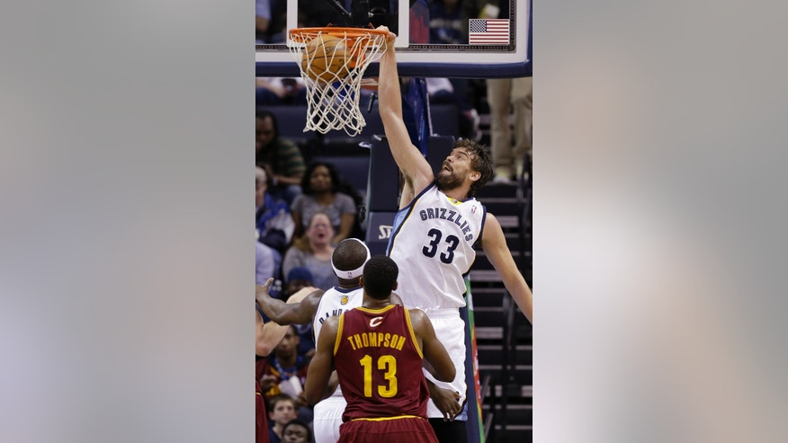 Memphis Grizzlies' Marc Gasol (33), of Spain, dunks in front of teammate Zach Randolph, left, and Cleveland Cavaliers' Tristan Thompson (13), of Canada, during the first half of an NBA basketball game in Memphis, Tenn., Saturday, March 1, 2014. (AP Photo/Danny Johnston)