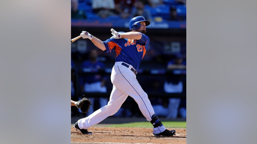 New York Mets' Lucas Duda watches his solo home run during the fourth inning of an exhibition spring training baseball game against the Miami Marlins Saturday, March 1, 2014, in Port St. Lucie, Fla. (AP Photo/Jeff Roberson)