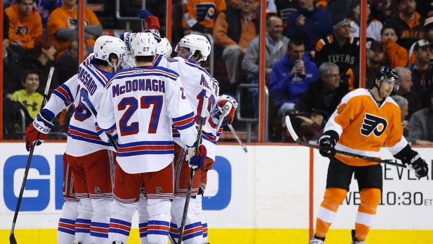 New York Rangers' Derick Brassard, left, celebrates with teammates after scoring a goal during the second period of an NHL hockey game against the Philadelphia Flyers, Saturday, March 1, 2014, in Philadelphia. (AP Photo/Matt Slocum)