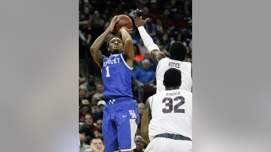Kentucky's James Young (1) hits his shot as South Carolina's Duane Notice tries to defend during the first half of an NCAA college basketball game Saturday March 1, 2014 in Columbia, S.C. (AP Photo/Mary Ann Chastain)