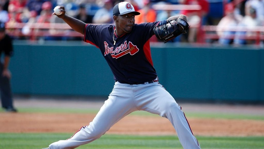 Atlanta Braves starting pitcher Julio Teheran throws in the first inning of a spring exhibition baseball game against the Washington Nationals, Saturday, March 1, 2014, in Viera, Fla. (AP Photo/Alex Brandon)