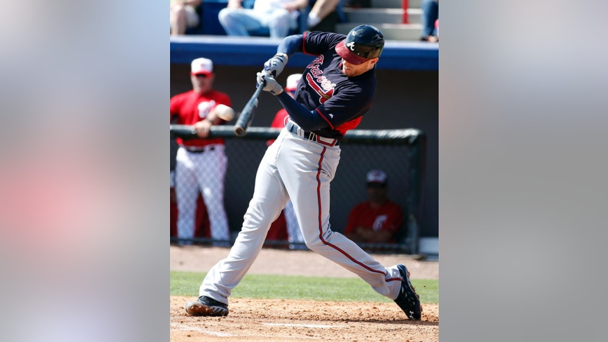 Atlanta Braves' Freddie Freeman hits a an RBI double in the third inning of a spring exhibition baseball game against the Washington Nationals, Saturday, March 1, 2014, in Viera, Fla. (AP Photo/Alex Brandon)