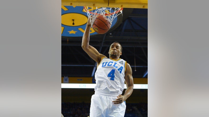 UCLA guard Norman Powell dunks during the first half of an NCAA college basketball game against Oregon State, Sunday, March 2, 2014, in Los Angeles. (AP Photo/Mark J. Terrill)