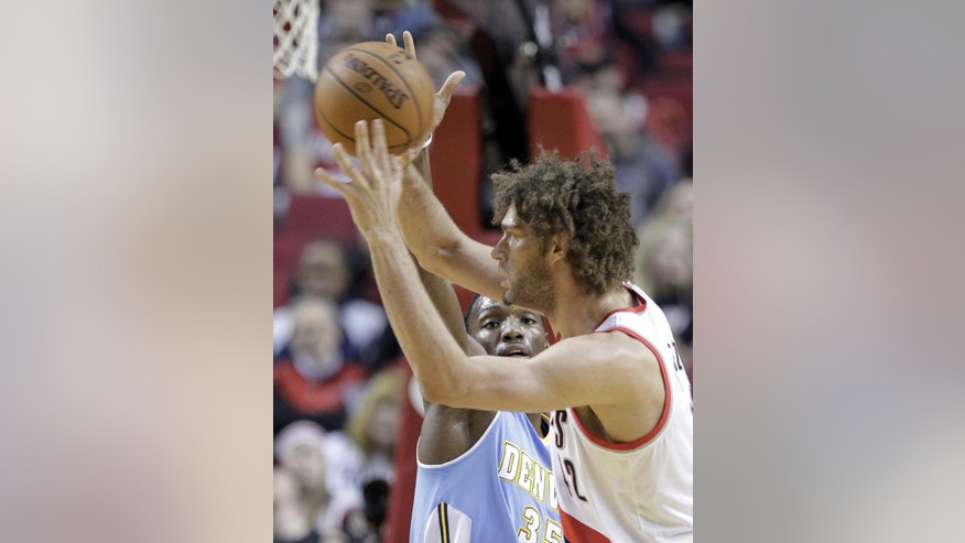 Denver Nuggets forward Kenneth Faried, left, defends against Portland Trail Blazers center Robin Lopez during the first half of an NBA basketball game in Portland, Ore., Saturday, March 1, 2014. (AP Photo/Don Ryan)