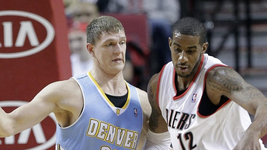 Portland Trail Blazers forward LaMarcus Aldridge, right, works the ball in against Denver Nuggets center Timofey Mozgov, from Russia, during the first half of an NBA basketball game in Portland, Ore., Saturday, March 1, 2014. (AP Photo/Don Ryan)
