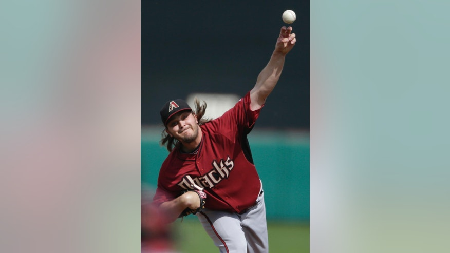 Arizona Diamondbacks starting pitcher Wade Miley throws to a San Diego Padres batter during the first inning of a spring training baseball game Sunday, March 2, 2014, in Scottsdale, Ariz. (AP Photo/Gregory Bull)
