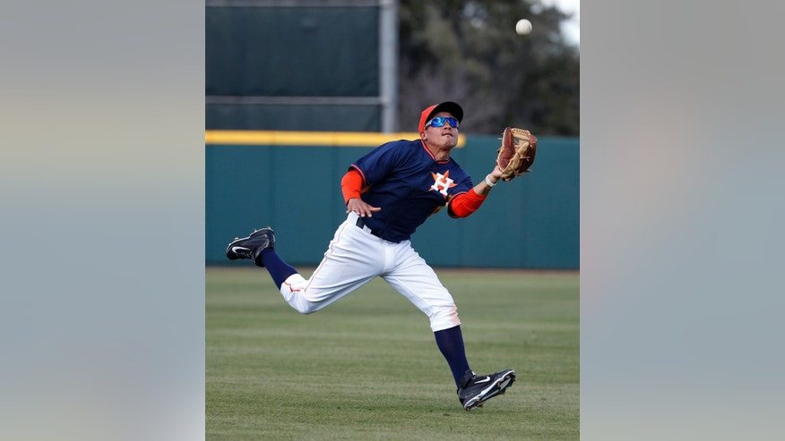 Houston Astros second baseman Ronald Torreyes catches a fly ball hit by Atlanta Braves' Edward Salcedo in the eighth inning of a spring exhibition baseball game, Sunday, March 2, 2014, in Kissimmee, Fla. The Astros won 7-4. (AP Photo/Alex Brandon)