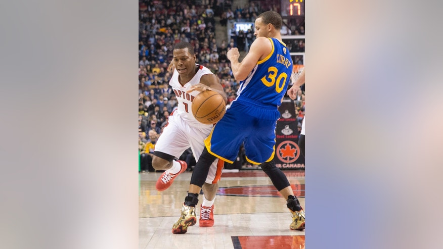 Toronto Raptors' Kyle Lowry, left, drives on Golden State Warriors' Stephen Curry during the first half of an NBA basketball game Sunday, March 2, 2014, in Toronto. (AP Photo/The Canadian Press, Chris Young)