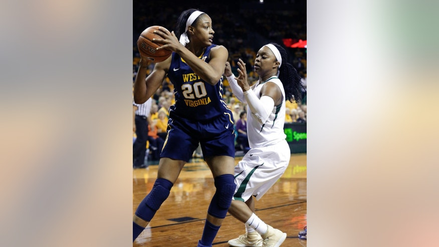 West Virginia center Asya Bussie (20) keeps the ball from Baylor guard Odyssey Sims (0) during the first quarter of an NCAA college basketball game Sunday, March 2, 2014, in Waco, Texas. (AP Photo/LM Otero)