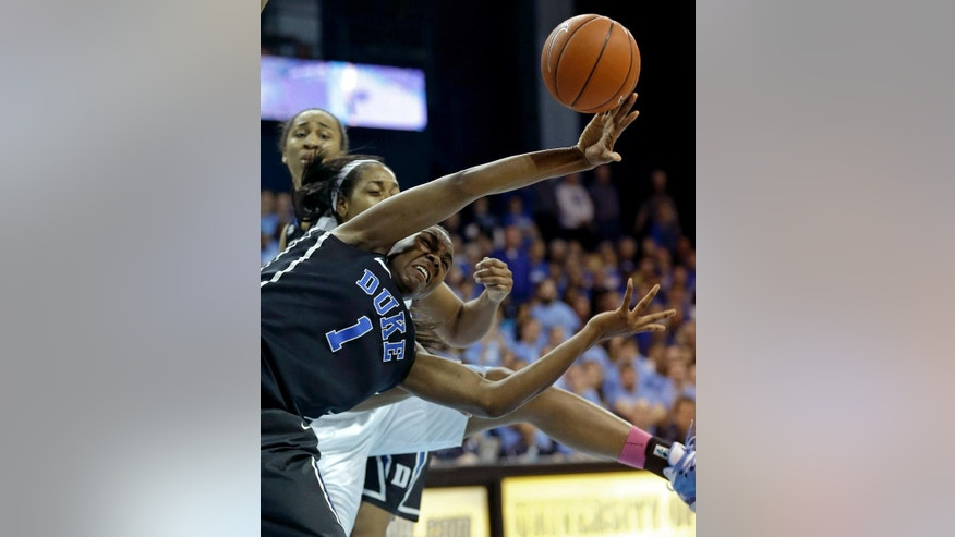 Duke's Elizabeth Williams (1) and North Carolina's Xylina McDaniel, rear, chase a loose ball during the first half of an NCAA college basketball game in Chapel Hill, N.C., Sunday, March 2, 2014. (AP Photo/Gerry Broome)