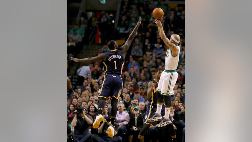 Boston Celtics point guard Jerryd Bayless (11) shoots against the defensive efforts of Indiana Pacers shooting guard Lance Stephenson (1) during the first half of an NBA basketball game on Saturday, March 1, 2014, in Boston. (AP Photo/Mary Schwalm)