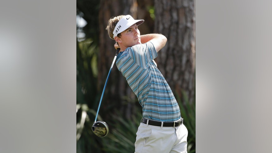 Russell Henley tees off on the second hole during the final round of the Honda Classic golf tournament on Sunday, March 2, 2014, in Palm Beach Gardens, Fla. (AP Photo/Lynne Sladky)