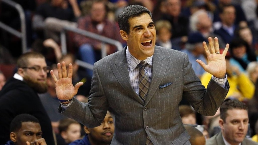 Villanova head coach Jay Wright reacts to a play during the first half of an NCAA college basketball game against Marquette, Sunday, March 2, 2014, in Philadelphia. (AP Photo/Matt Slocum)